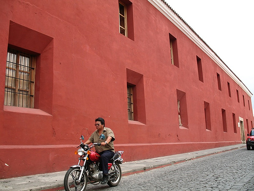 Red building, motorcycle and jeep