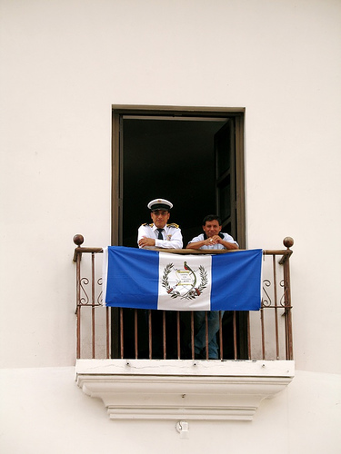 Guatemalan flag and guards in balcony