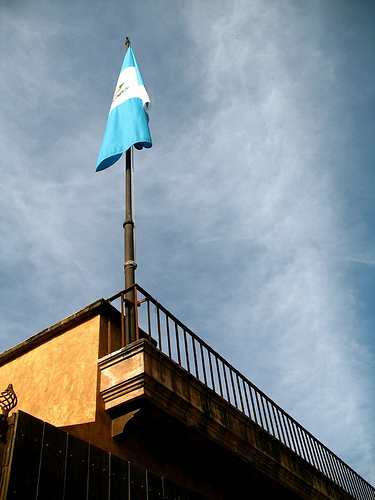 Guatemalan Flag at a Rooftop Pole