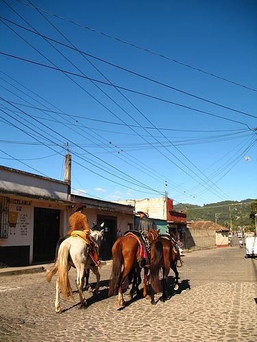 Horseback Riding Through Town