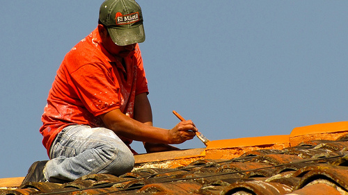 Repairing The Spanish-tile Roofs by  Rudy Girón
