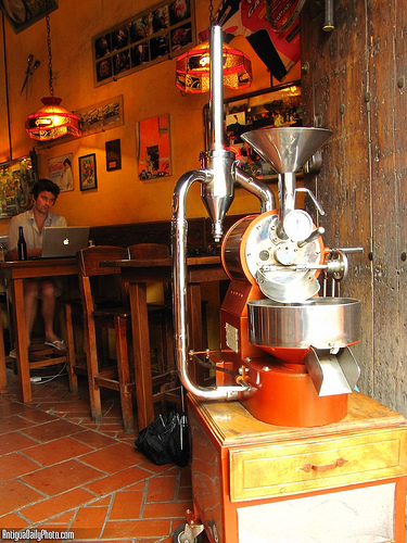 Coffee Roaster at Micho's Café by Rudy Girón