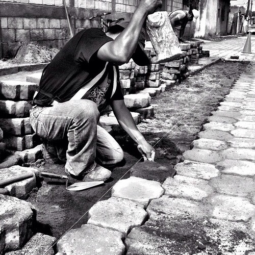 Paving streets by hand, one block at a time by Rudy Girón