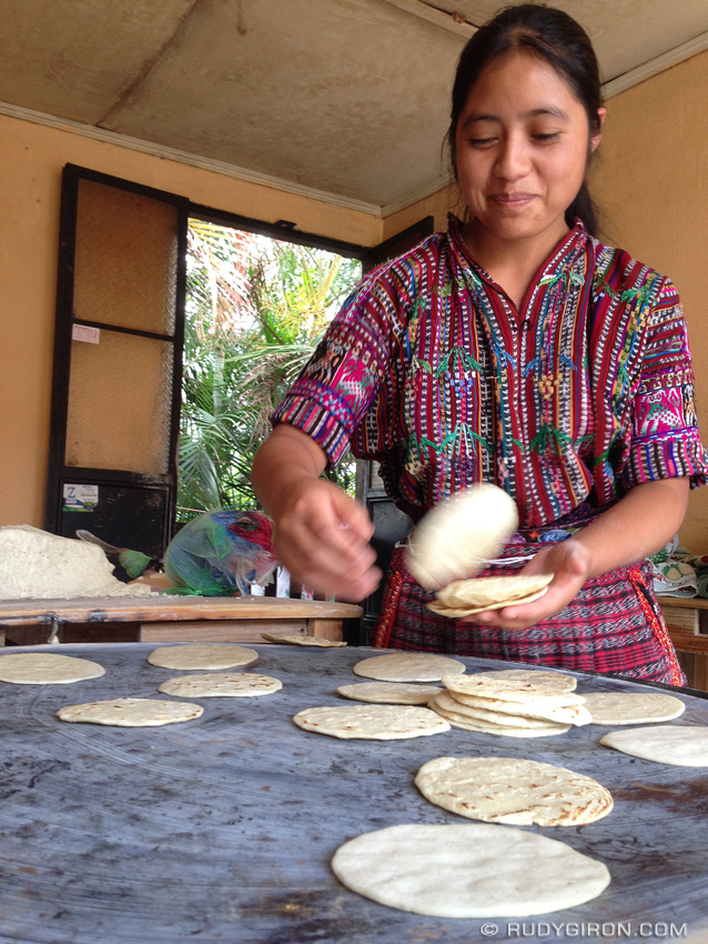 Rudy Giron: AntiguaDailyPhoto.com &emdash; Maya Girl Picking Freshly Made Tortitllas out of the Comal