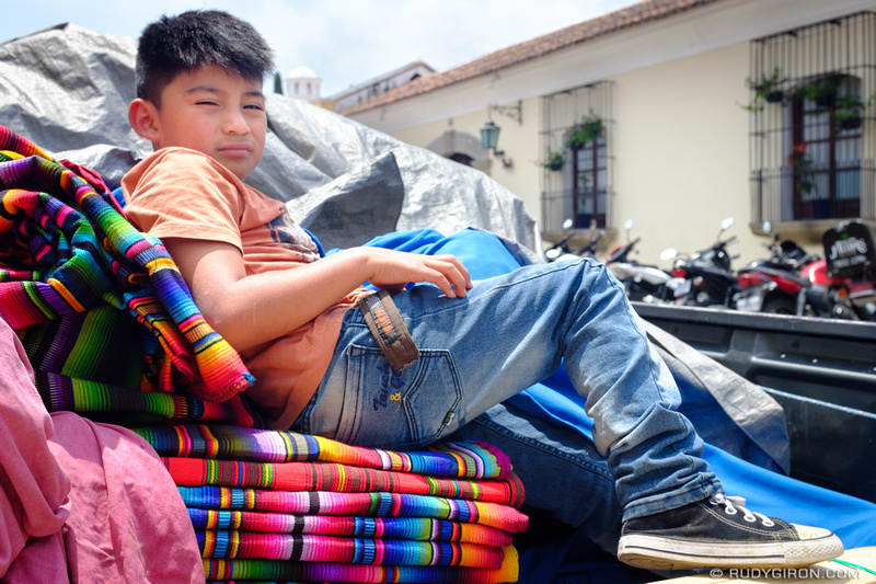 Rudy Giron: Antigua Guatemala &emdash; Boy Guarding The Colorful Textiles