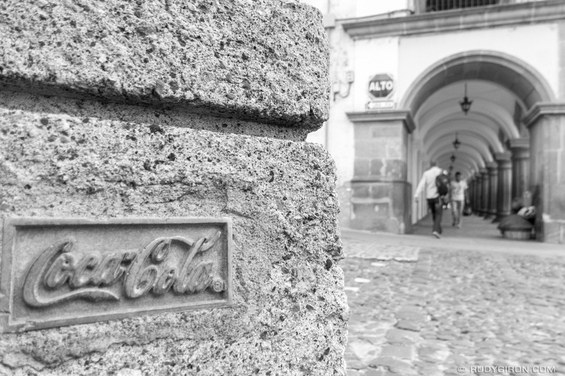 Rudy Giron: Antigua Guatemala &emdash; Street Photography — How about a Coca Cola sign at every light post in Antigua Guatemala? How was this approved?