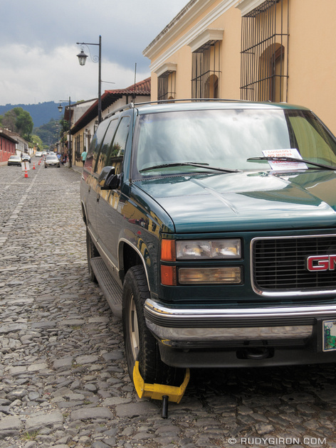 Rudy Giron: Antigua Guatemala &emdash; Wheel clampping vehicles parked in no-parking zones of Antigua Guatemala