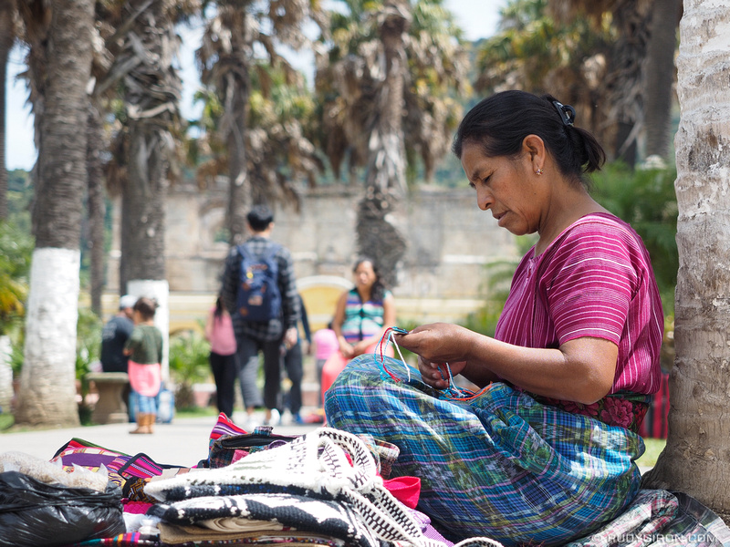 Rudy Giron: Antigua Guatemala &emdash; Maya woman making wristbands at the park