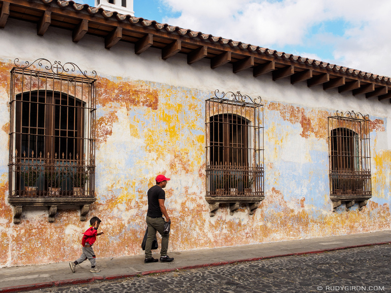 Rudy Giron: Antigua Guatemala &emdash; Guatemalan father and son walking in front of texture wall